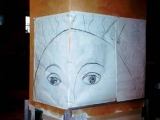 decorazione artistica occhi su mosaico a muro in progettazione